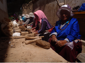 Ladies Mixing Clay With Cotton